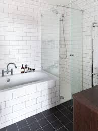 bathroom remodel ideas for small bathrooms be equipped white tile bathroom  and soaking bathtub plus corner