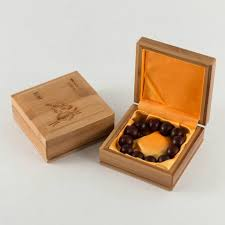 luxury jewelry packaging is custom made of natural bamboo and yellow satin made of natural