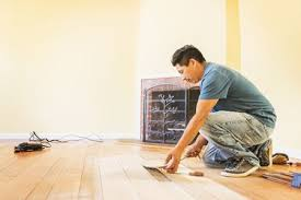 a man installing wood flooring