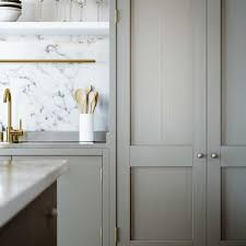 brushed nickel kitchen hardware. incredible kitchen with gray washed cabinetry paired brushed nickel cabinet pulls. hardware \