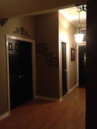 foyer black interior doors white trim cream walls scroll accent above door