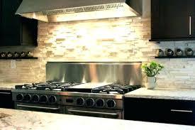 remove tile backsplash metal subway cabinets care of quartz replacing kitchen glass