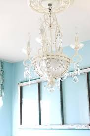 a chandelier s and chaos the laundry room a chandelier in chandelier the uk