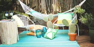 cancun outdoor rug in mediterranean shades of turquoise moss green
