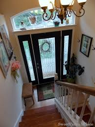 front door painted black on the interior side with black sidelights and white trim