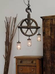 jam jar lighting attached to a pulley wheel chantelle lighting bespoke lighting uk