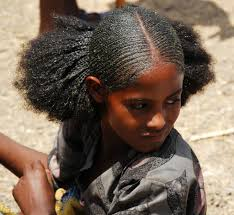 Ancient Egyptian Hair Style amhara youth with traditional braided hair which can also be 8660 by wearticles.com