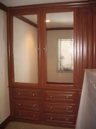 bedroom built in wall unit with brown varnish wooden also twins rectangle mirror plus drawers dresser cabinet design ideas