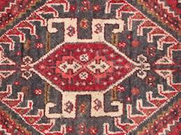 persian carpet pattern. scarab in a qashqai rug persian carpet pattern