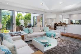 Example of a coastal open concept living room design in Gold Coast - Tweed  with white