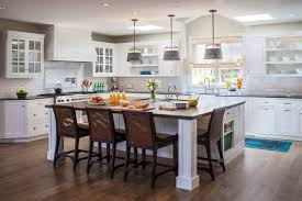 large kitchen islands with seating and storage cabinets chairs shelves drawers faucets flowers stove beach style