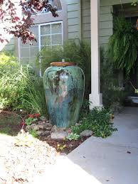 contemporary water fountain vase to the left and top is a large fountain urn urn water