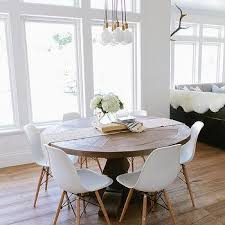 round salvaged wood dining table with br city chandelier 7