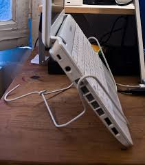 Wire coat hanger laptop stand - some people are very inventive.