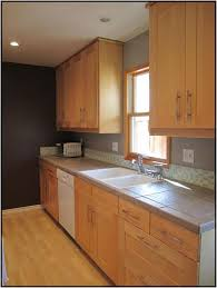 Maple Cabinets Gray Counters And Short Glass Backsplash
