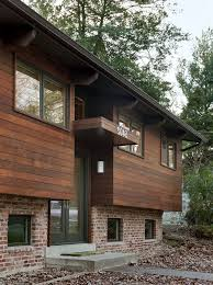 engineered wood siding with contemporary exterior and brick brick exterior canopy concrete walkway curb appeal dark brown glass front door dark trim