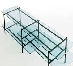supports shelves in the blue tinted clear glass composing a light and joyous combination of materials and colors and functional bonus