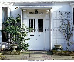 white double front door. Exterior Of White Victorian House With Painted Double Front Doors - Stock Image Door