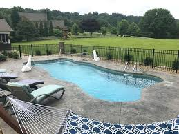 fiberglass pool with volleyball net for cool summer fun cost installation florida swimming advantages fiberglass pool cost
