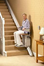 chair for stairs. Old-lady-at-stairs-lift Chair For Stairs -