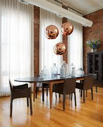 try this with multiple pendant lights ylighting blog over dining table lighting copper from tom dixon