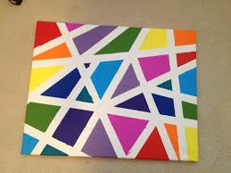 Canvas tape painting. Tape canvas using green painters tape in long  directional pieces. Paint