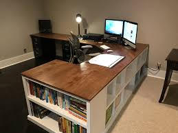l shaped brown wooden corner computer desk having shelf and