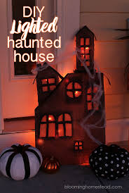 this diy lighted haunted house is so simple and easy to make be sure to check haunted house