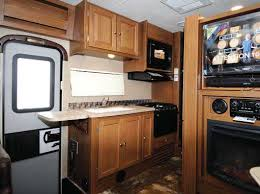 the compact galley is very well equipped we like the counter extension and the single piece sink cover