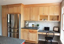 Kitchen Desk Area Shows A Shaker Door In Natural Birch Cabinets By