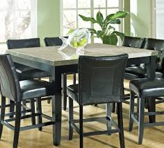 adorable granite dining table set in square shape with 8 black leather chairs and cute gl