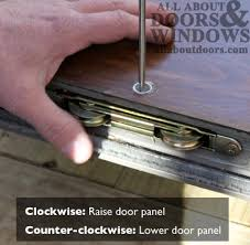 once rollers are installed insert a large flat head driver in the adjustment hole and turn counter clockwise to retract rollers