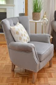 soft grey gray rolled arm accent chair with wood legs nail head trim living room before and after makeover with better homes gardens at