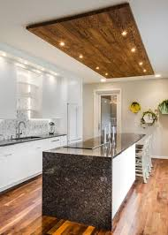 kitchen linear dazzling lights clear ceiling recessed: hgtv invites you to take a look at this contemporary kitchen with flat front white cabinets a wooden ceiling accent black granite countertops and recessed
