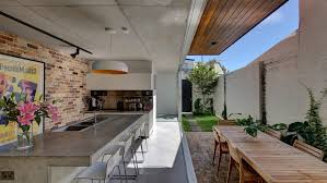 sydney contemporary pendant lighting with metal counter height stools kitchen and polished concrete top industrial finishes