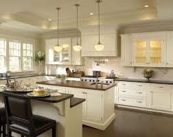 kitchen dark quartz countertops glass vase dark countertop dual sinks industrial pendant champagne bucket recessed light