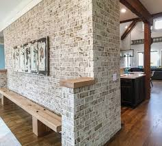 interior brick wall interior brick accents and defines open floor plan in modern rustic home
