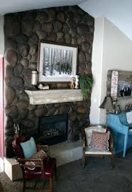 fireplace stones rocks fireplace makeover stained river rock and painted and distressed mantel read between designs