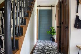 painted cement tile floors with green barn door