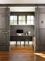 home office in kitchen. dramatic sliding doors separate the small home office from kitchen and dining area design in t