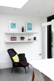 bespoke grey wall shelves and white wall rails mounted at high level