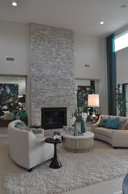 for this space the focal point is the fireplace it is tall and bold helping the room feel taller it also has diffe textures making it stand out