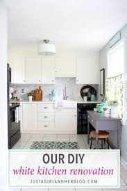love this stunning diy white kitchen they used ikea sektion cabinets quartz countertops