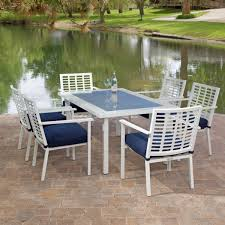 patio white metal outdoor furniture with blue cushions installed