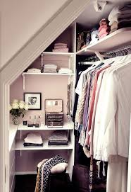 tiny walk-in closet with a leading rack on the right and open shelving in