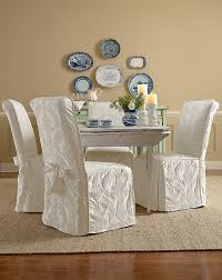 furniture dining room chair with white fabric chair cloth complete with ribbon on cream rug