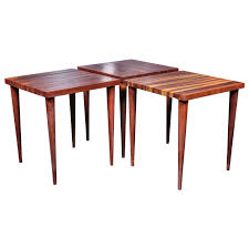 set of  solid vintage walnut stacking tables by mel smilow at stdibs