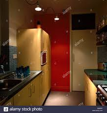 red pendant lighting. Pendant Lighting In Modern Red Galley Kitchen With Large American-style Fridge-freezer O