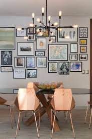 black picture frames wall. Prints And Photos Surrounded By Simple Black Frames Hang On The Wall Behind Dining Table In This Apartment Add Color, Personality, Life To Picture