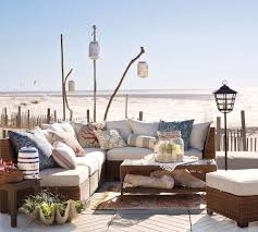 beach looking furniture. Pottery Barn Beach Furniture For Outdoor Living Room With L Shape Rattan Sofa And Standing Candle Lantern Looking U